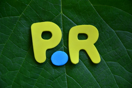 word pr on an abstract background