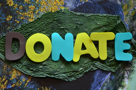 word donate on an abstract background Stock Photo