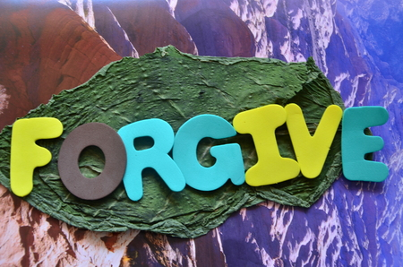 wd forgive on an abstract background Archivio Fotografico