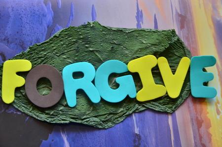 mot pardonner sur un fond abstrait
