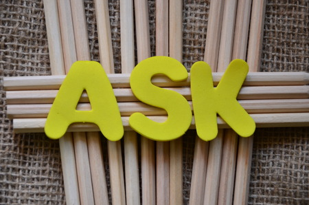 word ask with burlace background