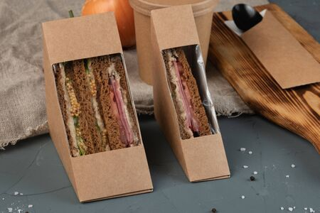 Soup and sandwiches in eco packaging - with fresh vegetables, tuna, lean vegetable ham. Vegan food.