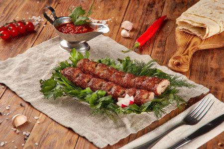 Kebab grill BBQ, wood background