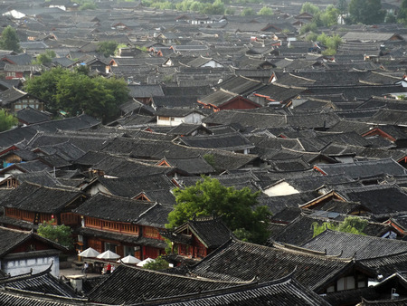 increasingly: Morning overlooking the town, the mist becomes increasingly quiet roof tiles.  Editorial