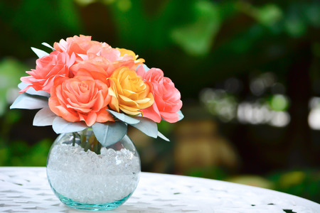 handmade a roses made from paper coffee filter add  a vase to decorate the garden photo