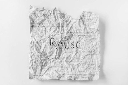 the word reuse on a recycle paper photo