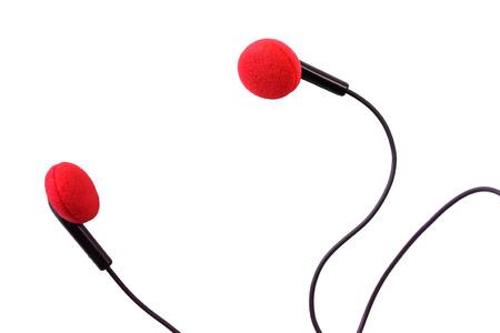 red audio earphones on white background photo