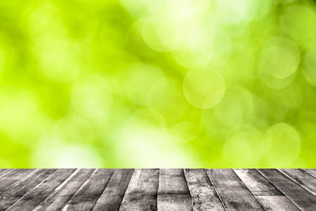 soft green bokeh background and wooden floor photo
