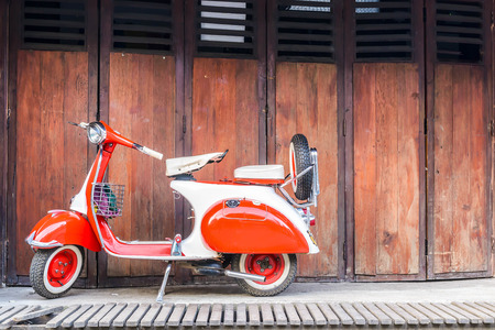 mini bike: the vintage Vespa in old background on street at countryside,Pai , thailand