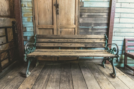 tableau: classic old wooden bench at retro background