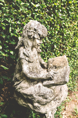 Classic Image Garden Statues A Little Girl In Vintage Style Stock Photo    35018143