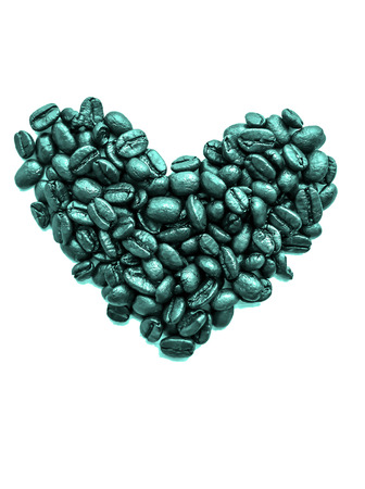 Colorful heart of coffee beans on white background photo