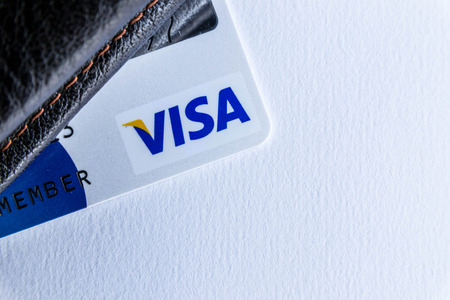 foreign currency: Selective focus on letter Visa,Master Card with foreign currency Editorial