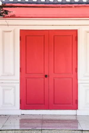 dorset: old red wooden door