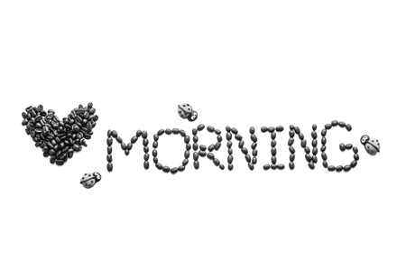 short phrase: coffee beans  used to spell love morning on white  background Stock Photo