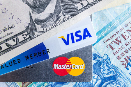 2 50: Selective focus on letter Visa,Master Card with foreign currency Editorial