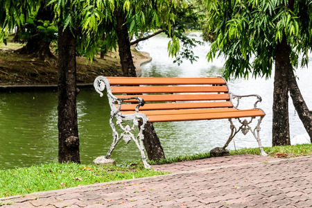 park bench with a riverside beautiful background photo