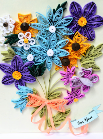 quilling: a flowers made from paper stripes its name Quilling paper Stock Photo