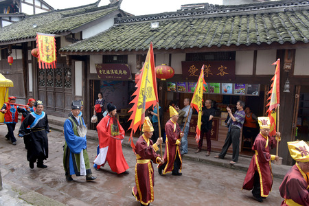 magistrate: Performers with traditional costumes in the old street