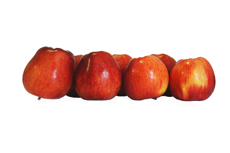 Apples. Expanded into the ranks, one after another. Apples are ripe and shiny. The color is dark red with yellow. Smooth outline. Background white, isolated.