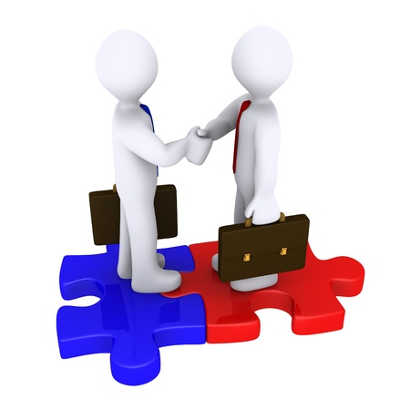 Handshake between two 3d businessmen standing on puzzle pieces photo
