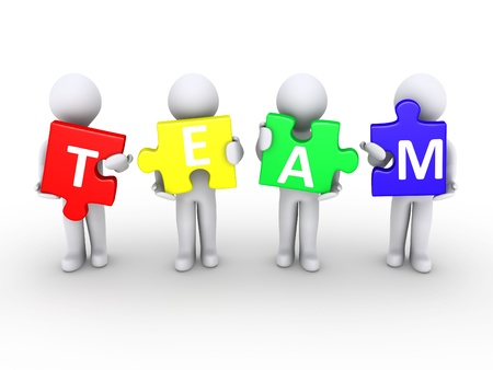 Four 3d persons holding puzzle pieces that form the word team Stock Photo