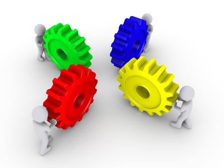 Four 3d people pushing different colored cogwheels photo