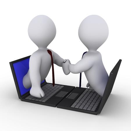 contrato de trabajo: Dos hombres de negocios se dan la mano a través de pantallas de ordenadores portátiles