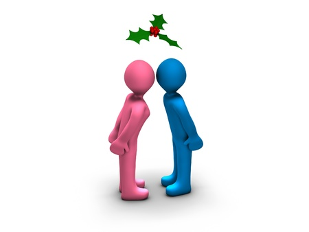 Boy and girl kissing under a mistletoe photo