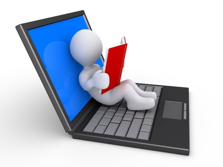 3d person is reading a book while relaxing on an opened laptop