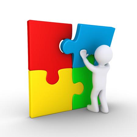 3d persoon zet laatste puzzelstukje Stockfoto - 26932916