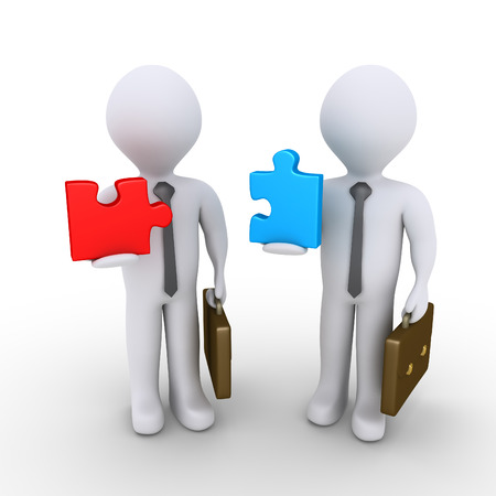 Two 3d businessmen are holding different puzzle pieces photo