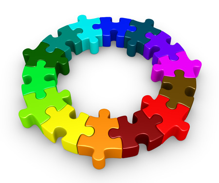 business puzzle: Different colored puzzle pieces are connected forming a circle Stock Photo