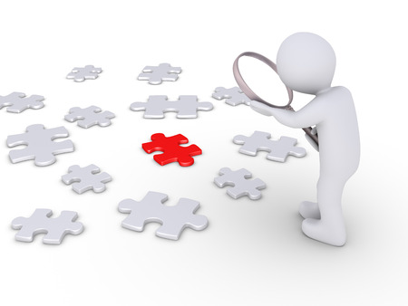 Person holding a magnifier is looking at many puzzle pieces but one is different Stock Photo