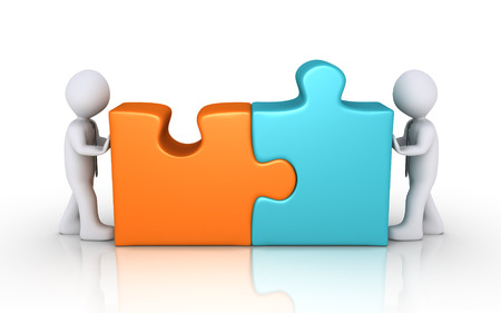 Two businessmen connect different colored puzzle pieces