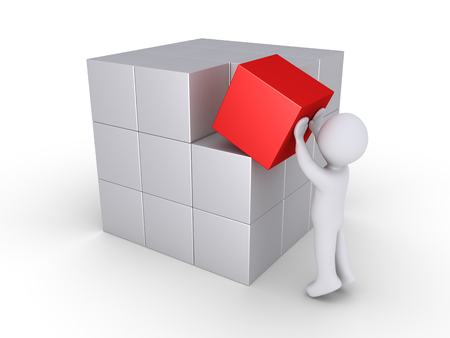 red cube: Person is putting the special piece of the cube construction Stock Photo