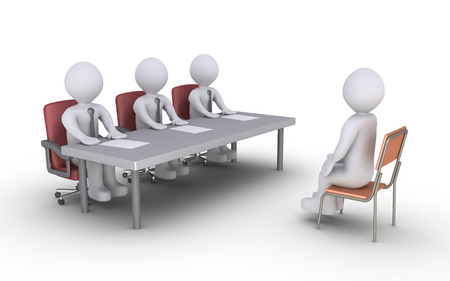 a table: Businessmen sitting behind a desk and a person is sitting in front of them as conducting an interview