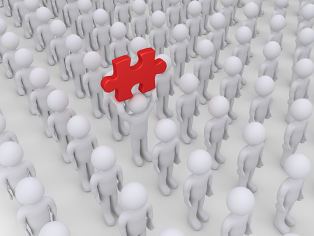 distinguish: Many people in rows but one is holding high a puzzle piece