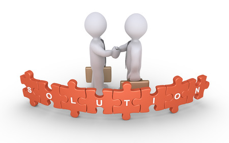 shakes: Businessmen shake hands behind the puzzle pieces with the Solution word on them