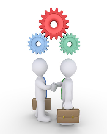 uniting: Two businessmen shake hands and connected cogwheels are over their heads