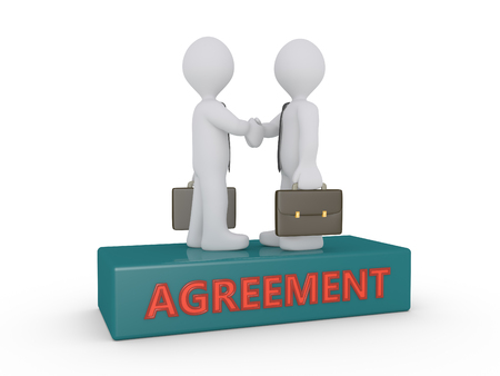 Two businessmen shake hands on podium with agreement word on it Reklamní fotografie
