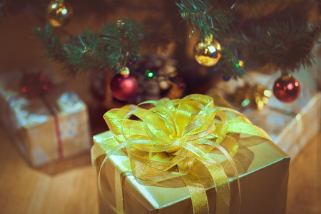 christmas tree presents: Christmas presents under a Christmas tree with defocused lights