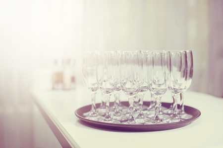 celebratory event: Glasses with white wine on blurred background