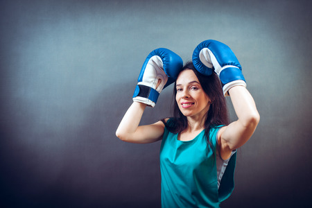 Young woman training punch boxing gloves Stock Photo