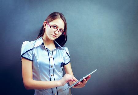 Beautiful business executive using digital tablet, studio Stock Photo