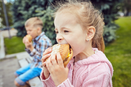 avocation: Close-up of two friends eating hamburger