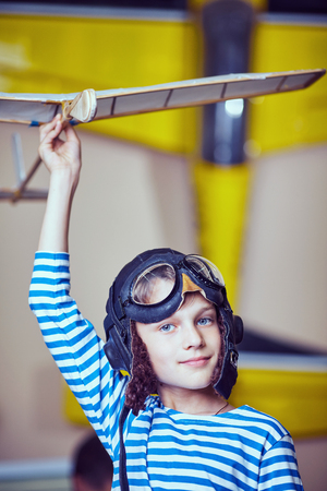 vise: A boy in the workshop wearing a pilots helmet Stock Photo