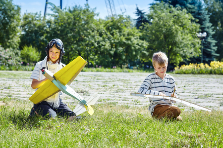 A child launches a model airplane