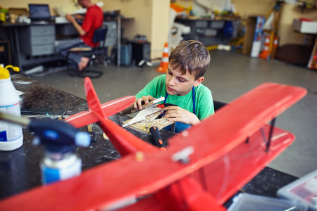 vise: The teen is building an airplane