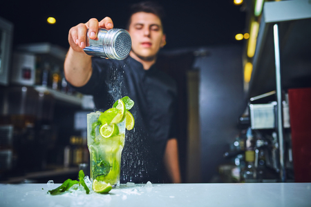 Barman at work, preparing cocktails.concept about service and beverages. Stock Photo